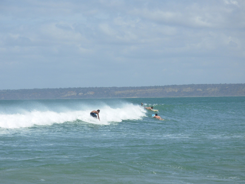 Surfing in Cabo Ledo beach