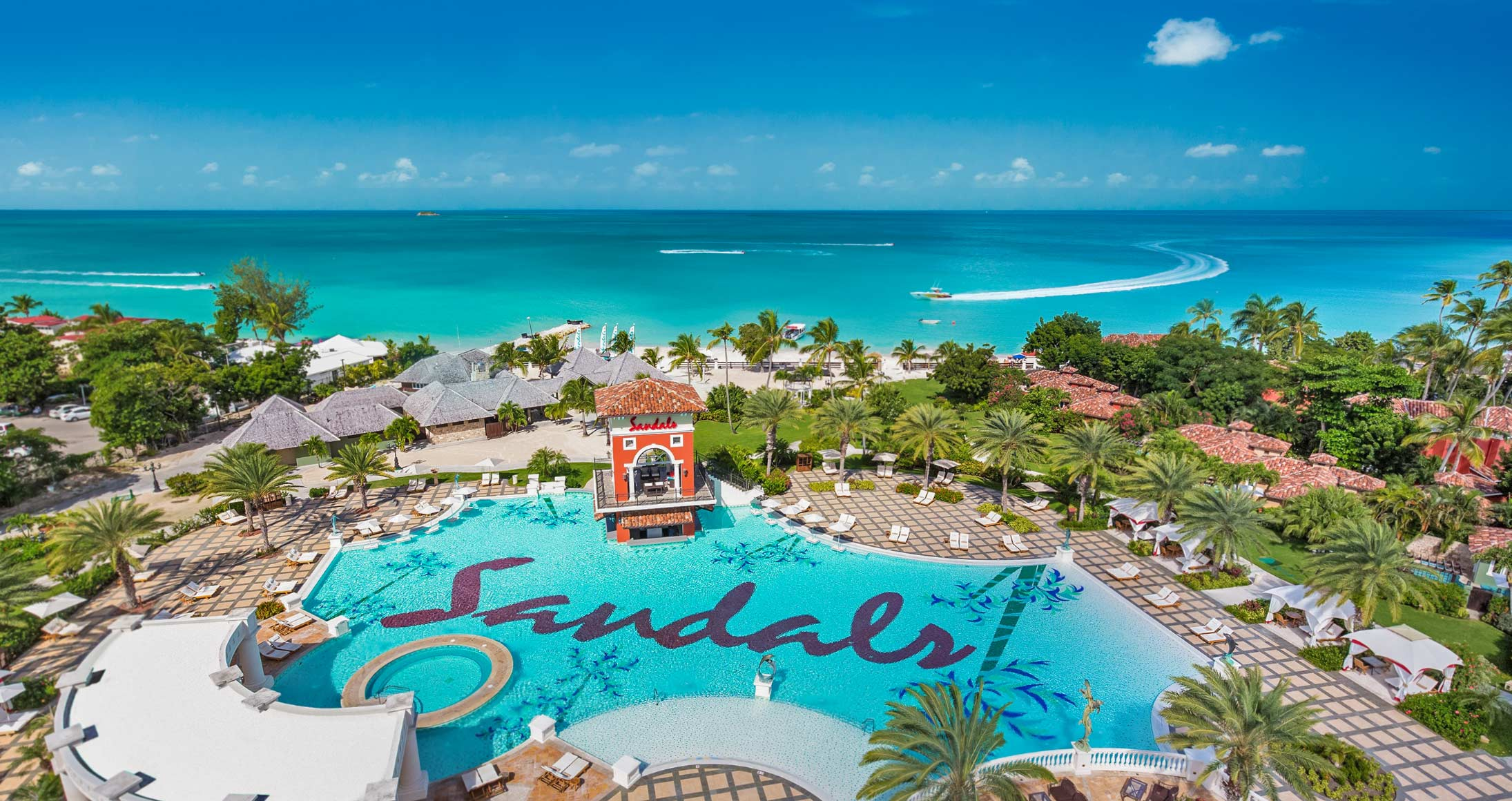 sandals aerial pool beach ocean boat resort
