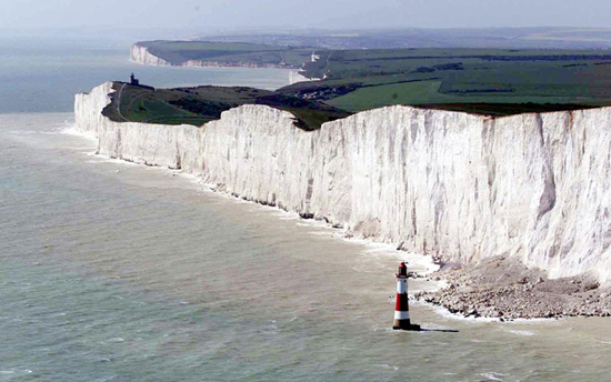 Reckless trio pictured dangling legs off Beachy Head
