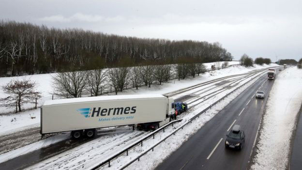 Snow causes power cuts and travel delays due to bad weather