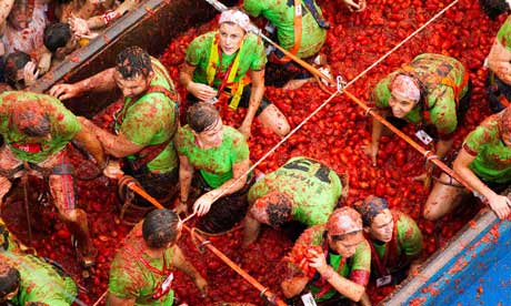 Hard-hit Spanish town charges fees for tomato fight
