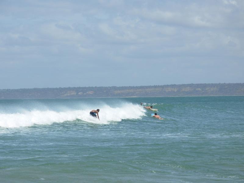 Surfing in Cabo Ledo beach